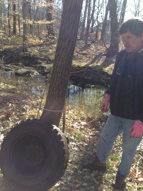 Tire with rim pulled from the creek behind Graylyn Crest